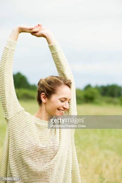 woman stretching, portrait - arms raised stock photos and pictures