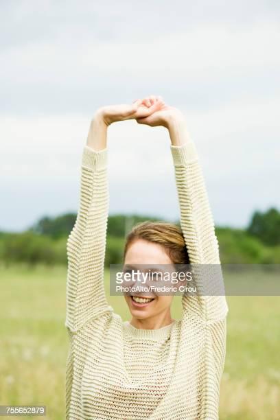 Woman stretching, portrait