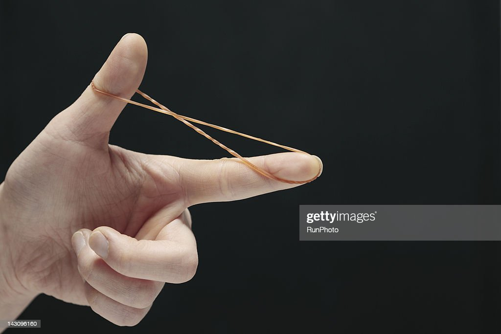 woman stretching rubber band,hand close-up : Stock Photo