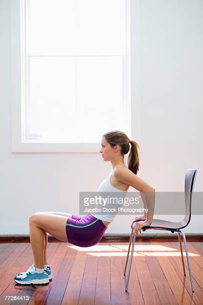 Woman stretching with chair