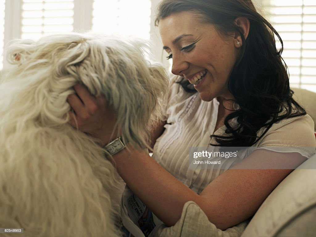 Woman stroking her dog : Stock Photo