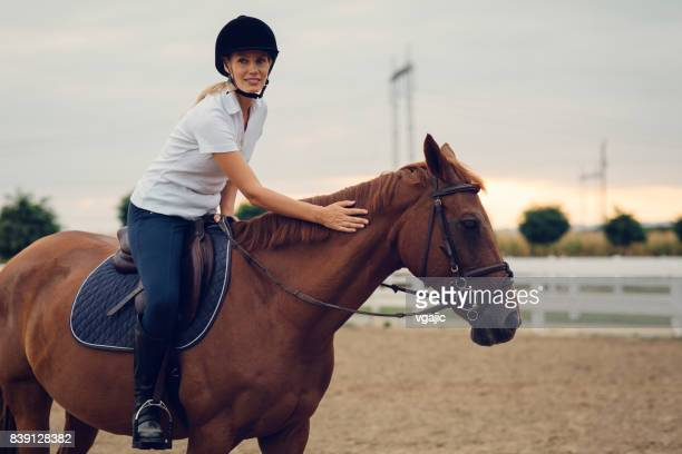 Woman stroking her horse