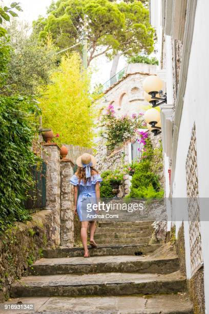 Woman strolling along the streets of Capri