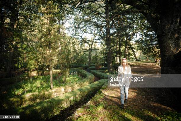 woman strolling in vineyard woodland - heshphoto photos et images de collection