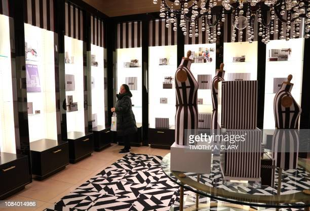 A woman strolls through the luxury retailer Henri Bendel flagship store on 5th Avenue January 17 2019 on the last day of business for the iconic...