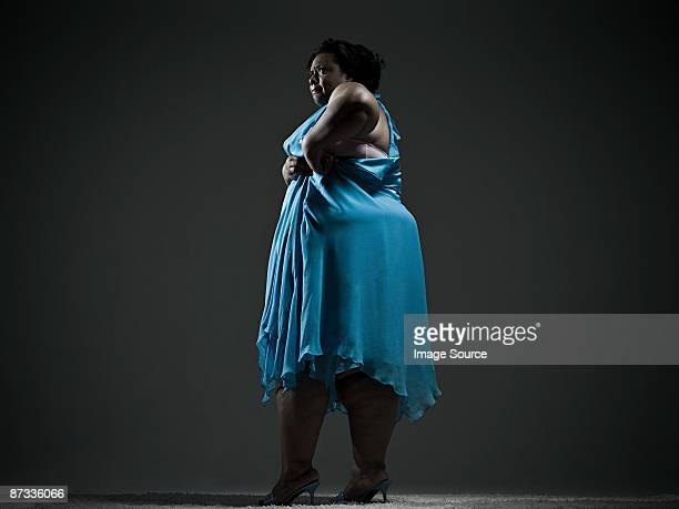 woman struggling with dress - images of fat black women stock photos and pictures