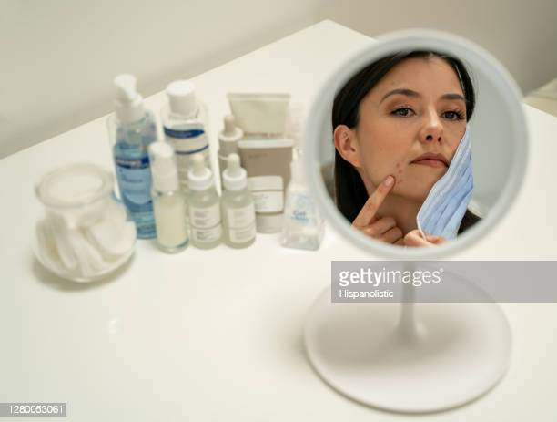 woman struggling with mask related acne on her chin after wearing a facemasks - face mask beauty product stock pictures, royalty-free photos & images