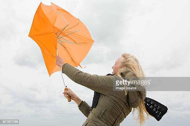Woman struggling with umbrella