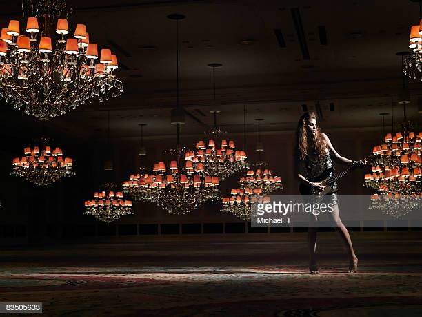 woman struming the guitar in a ballroom - japanese short skirts stock pictures, royalty-free photos & images