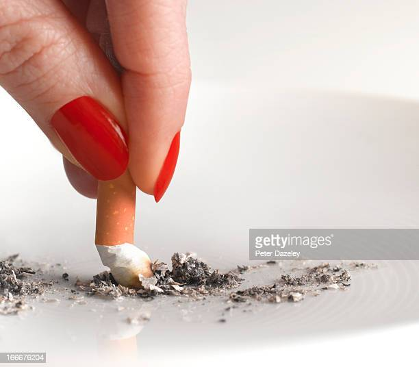 Woman stubbing out cigarette