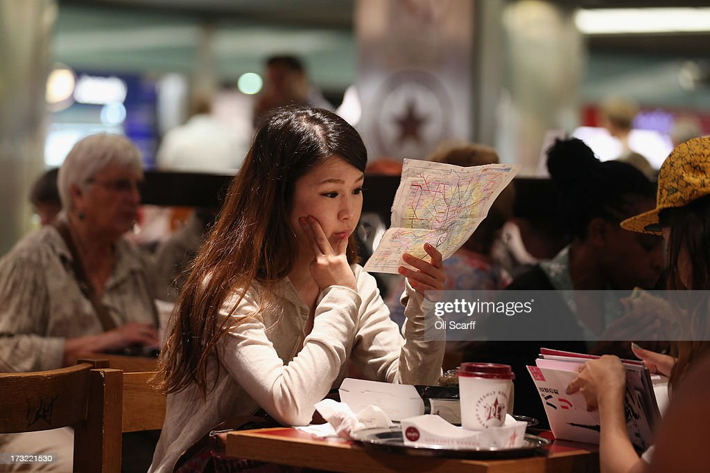 A woman studies a map of the London Underground network in a cafe on July 10, 2013 in London, England.