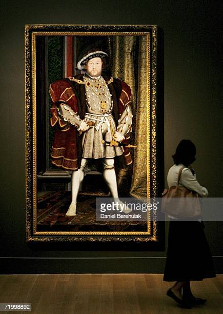 A woman studies a portrait of King Henry VIII by Hans Holbein at the Tate Britain Holbein In England exhibition on September 26 2006 in London...