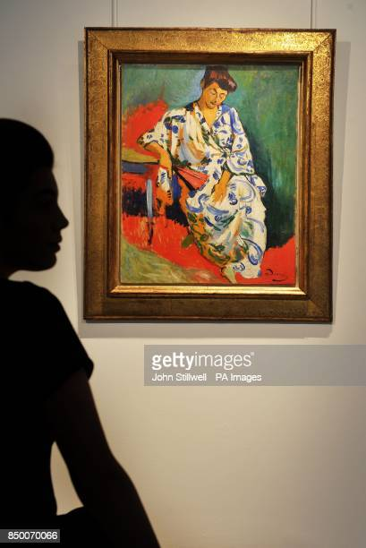 A woman studies the Andre Derain painting of Madame Matisse au Kimono painted in 1905 on view in the Christie's Auction rooms in central London and...