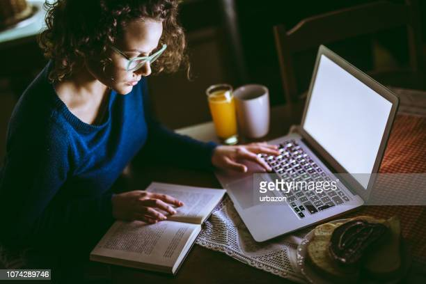 woman studying for finals at home - diploma stock pictures, royalty-free photos & images
