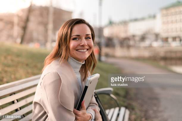woman studying on her laptop in the park - scandinavian descent stock pictures, royalty-free photos & images
