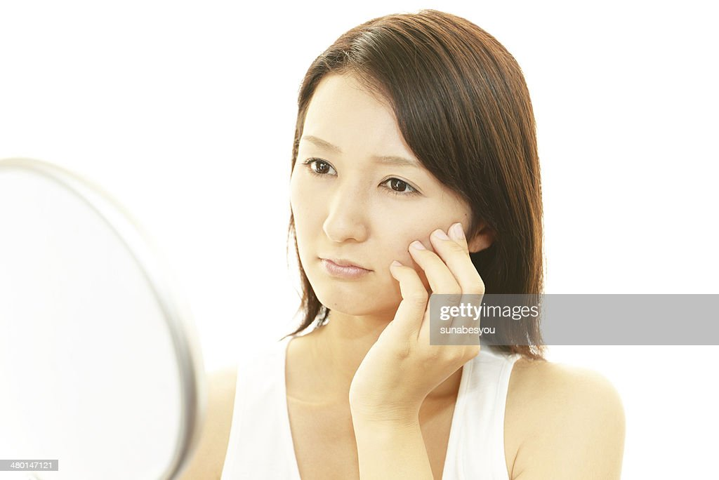 Woman suffer from wrinkles : Stock Photo