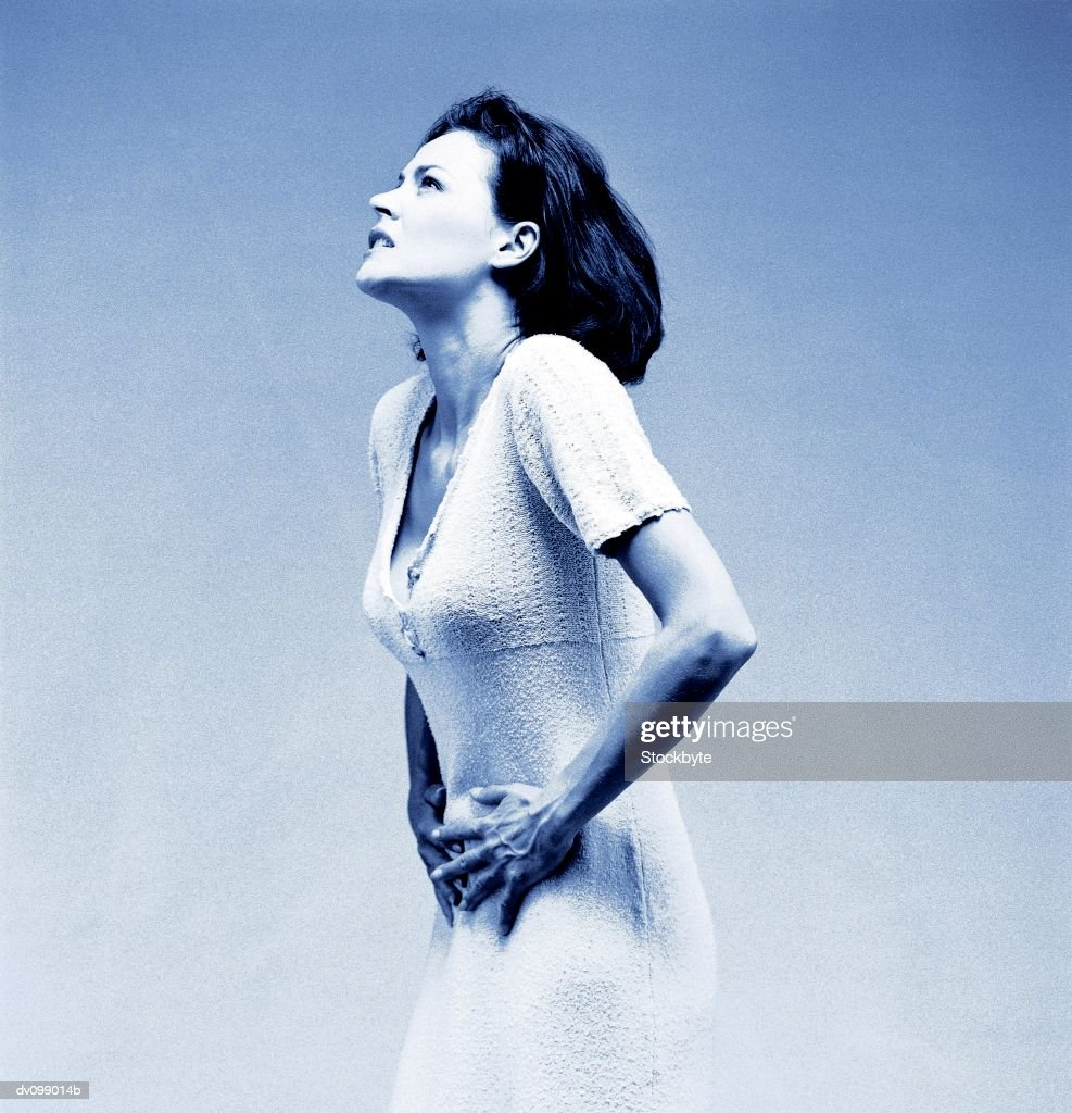 Woman suffering from abdominal pain : Stock Photo