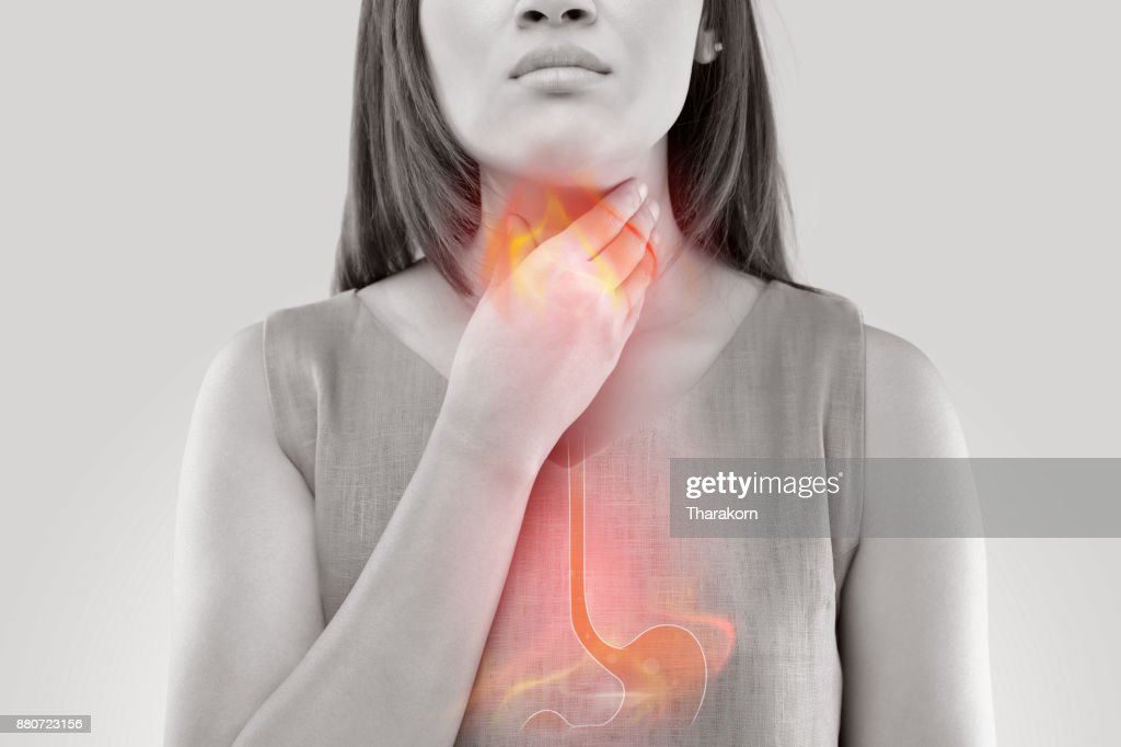 Woman Suffering From Acid Reflux Or Heartburn-Isolated On White Background : Stock Photo