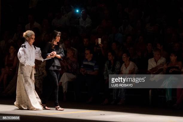 A woman suffering from Alzheimer's models a creation by Colombian designer Guio Di Colombia during the Walkway Inclusion fashion show in Cali...
