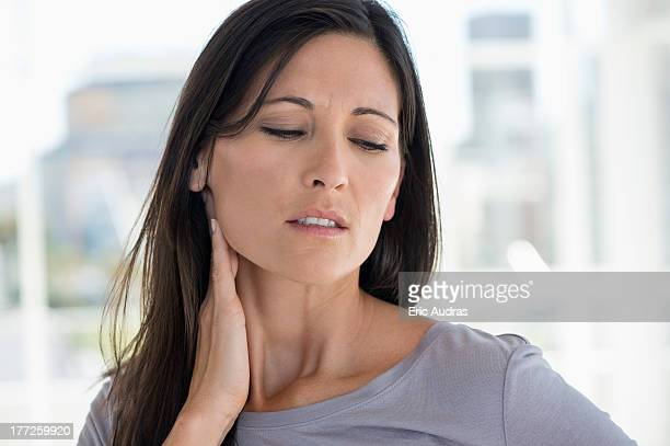 Woman suffering from an neck ache