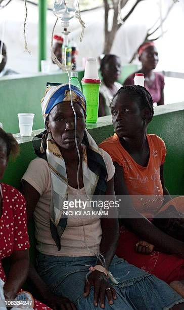 A woman suffering from dehydration and diarrhea waits to be treated at the Charles Colimon Hospital in Petite Riviere on the Artibonite River...