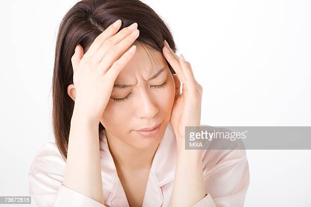 A woman suffering from headache