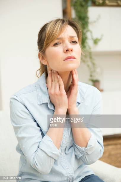 Woman suffering from sore throat