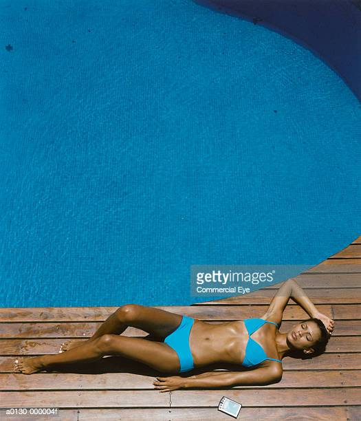 woman sunbathes near pc - swimwear stock pictures, royalty-free photos & images