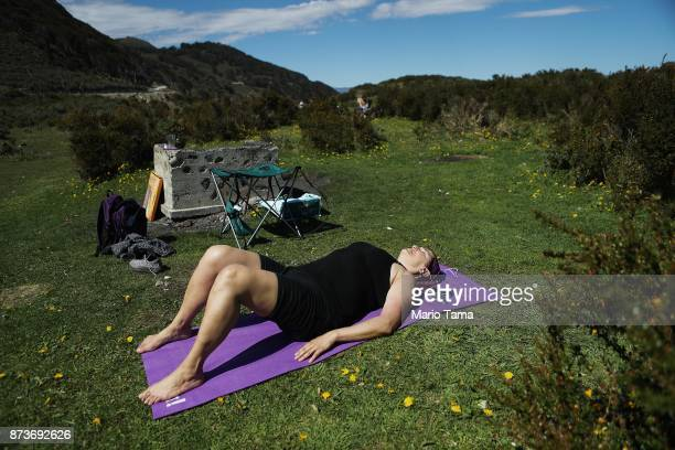 A woman sunbathes on a warm spring day where temperatures hit a daily record of 66 degrees Farenheit on November 6 2017 in Ushuaia Argentina Ushuaia...