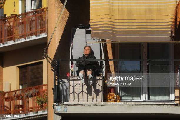 A woman sunbathes on her terrace during lockdown on March 23 2020 in Rome Italy As Italy extends its nationwide lockdown to control the spread of...