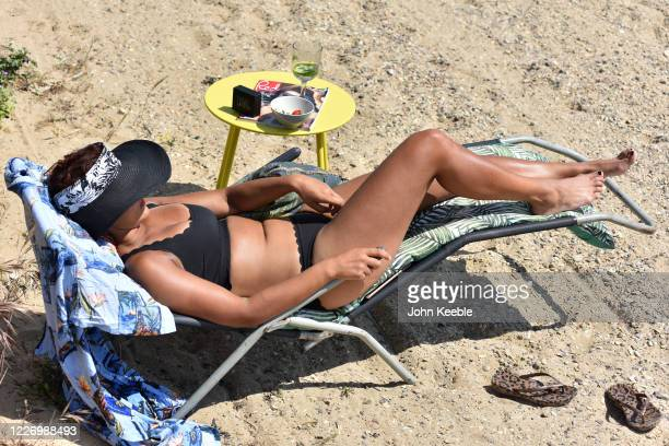 A woman sunbathes on the beach on a warm and sunny May Day bank holiday on May 25 2020 in SouthendonSea United Kingdom The British government has...