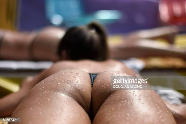 A woman sunbathes using insulating tape at a beauty center in Belo Horizonte Brazil on December 21 2017 Brazilian women take advantage of the...