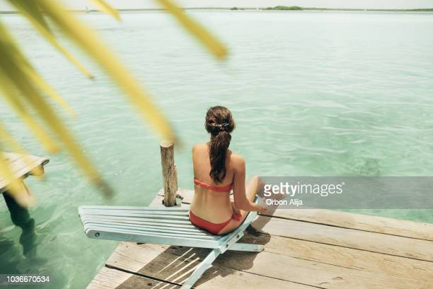 woman sunbathing in bacalar - lagoon stock pictures, royalty-free photos & images