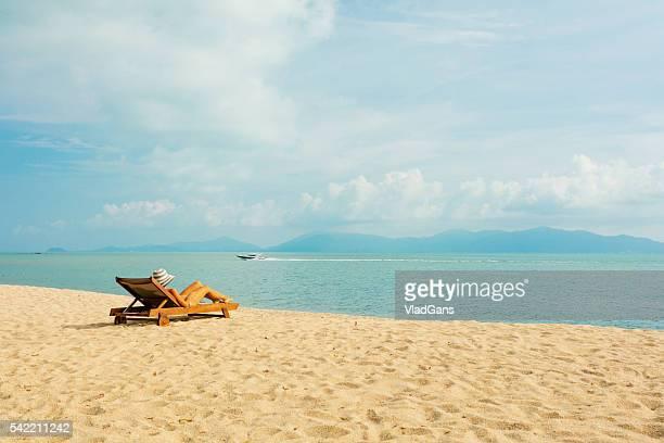 woman sunbathing in beach chair