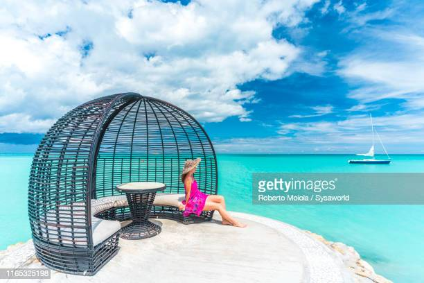 woman sunbathing in wood gazebo, caribbean sea - barbados stock pictures, royalty-free photos & images