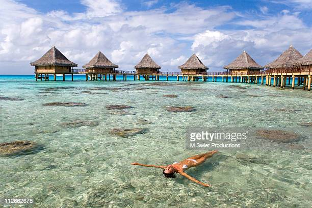 Woman sunbathing luxury resort
