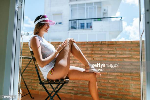 Woman sunbathing on a balcony