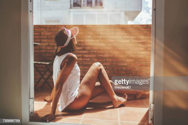 woman sunbathing on a balcony - hot legs stock photos and pictures