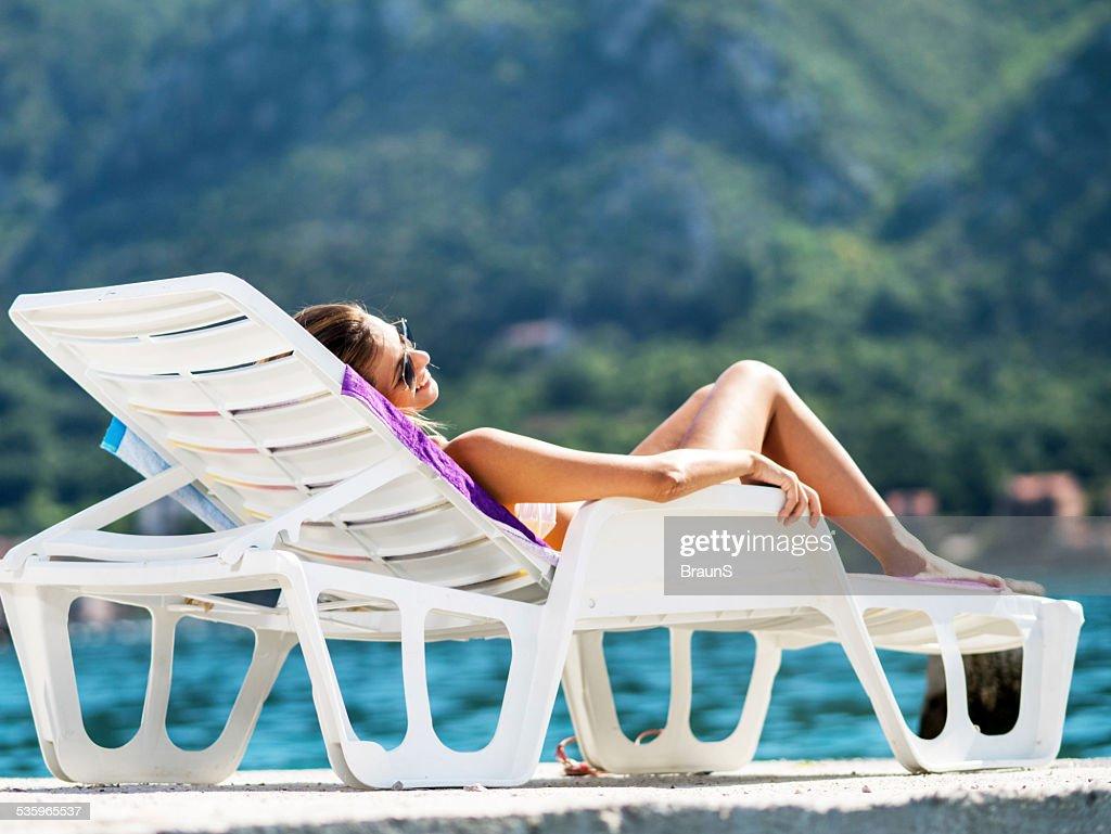 Woman sunbathing. : Stock Photo