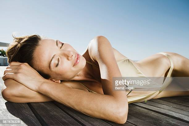 woman sunbathing - beautiful hips stock photos and pictures