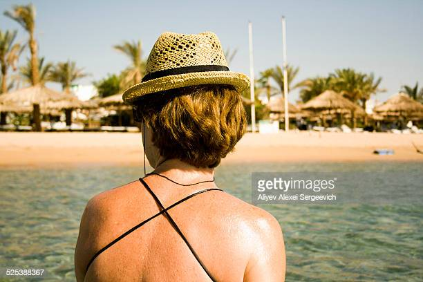 Woman sunning by seaside, Sharm El Sheikh, Egypt