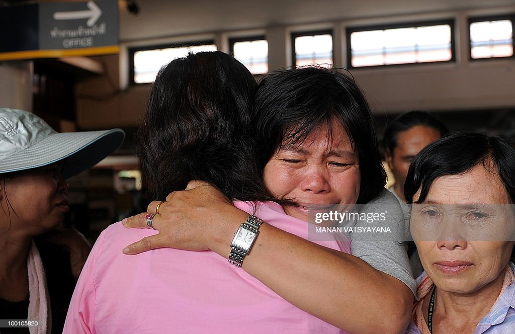 A woman supporter breaks down after welcoming Red Shirt protestors arriving on a train from Bangkok at the train station in Chiang Mai around 700kms from Bangkok on May 21, 2010. Thailand picked up the pieces after violence and mayhem triggered by a crackdown on anti-government protests, as the focus swung to recovery and reconciliation in a divided nation.