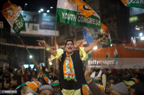 Woman supporter of Indian National Congress, India's main opposition political party responds to the slogans of Rahul Ghandi, congress party...