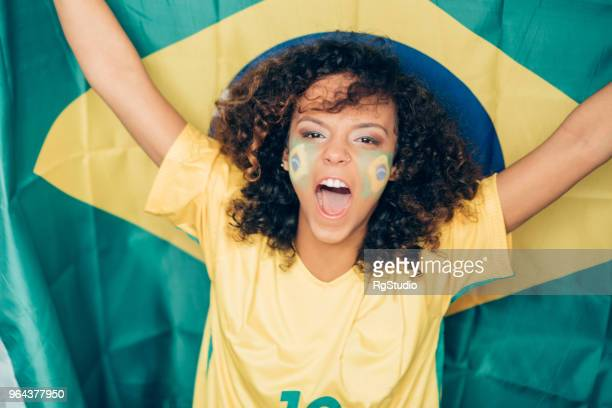 woman supporting brazil on soccer world championship - soccer body painting stock photos and pictures