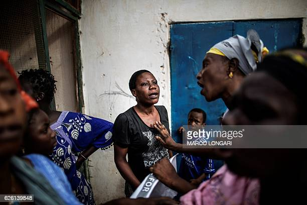 Woman supportring the incumbent Gambian president Yahya Jammeh, quarrels with supporters of Adama Barrow, the flag-bearer of the coalition of the...
