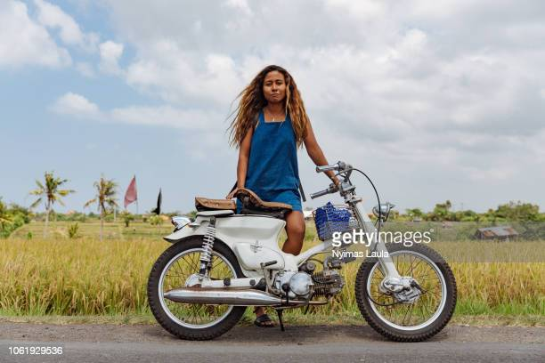 Dark skinned woman with motorcycle