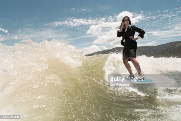 Woman Surfing in Dry Business Attire while Chatting on the Phone