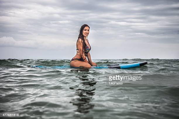 Woman surfing in the ocean