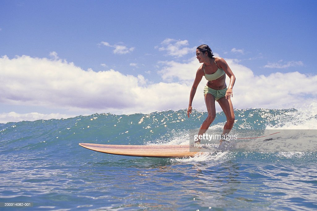 Woman surfing on ocean wave : Stock Photo
