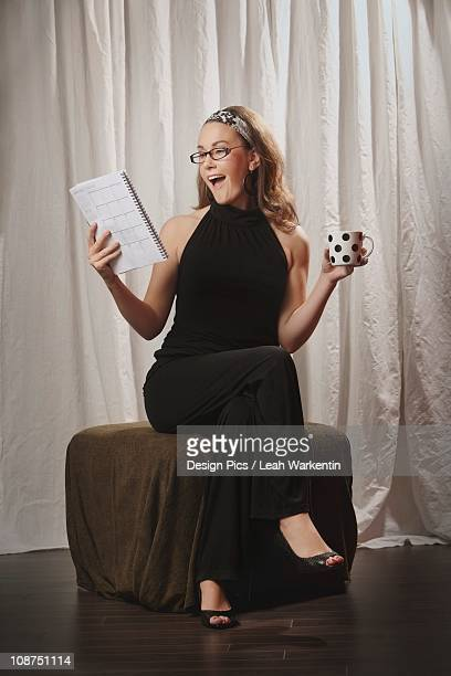 a woman surprised while reading from a document - audition stock pictures, royalty-free photos & images